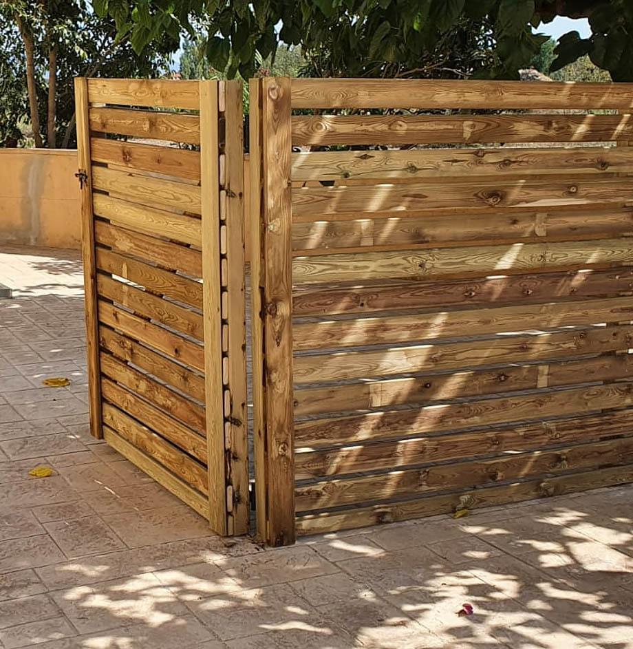 tanca de llistons de fusta